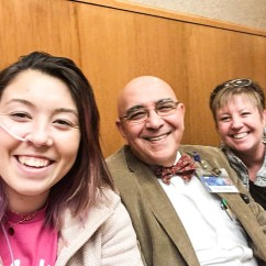 Emma. her doctor from the Mayo Clinic and her Mother smile for a selfie in the Gastrointestinal Department of the Clinic. This doctor saved her life.