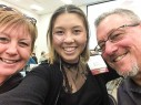 Emma's Mom, Emma, and Emma's Dad smile for a selfie at her Scholarship Awards Luncheon. Emma is a Professional Communications Major at Gateway Technical College.